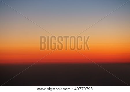 Background of the sky at the beginning of sunrise above clouds