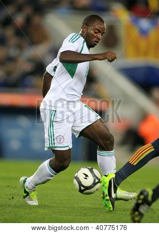 BARCELONA - JAN, 2: Nigerian player Sunday Mba in action during the friendly match between Catalonia and Nigeria at Estadi Cornella on January 2, 2013 in Barcelona, Spain