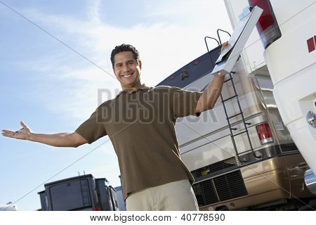 Happy Salesperson on RV Lot