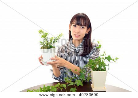 Smiling woman with potted plants
