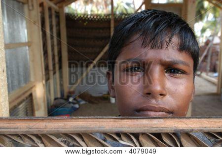 Boy Rebuilding House
