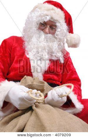 Santa Tying Up Sack With Presents