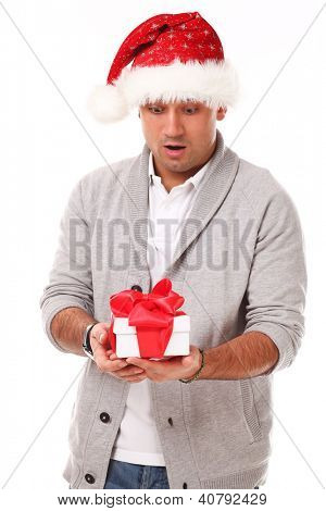 Young caucasian handsome man in christmas hat surprised  isolated over white background