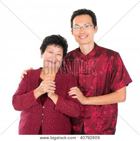 Happy Chinese New Year. Happy Asian Chinese family with gesture of congratulation over white background