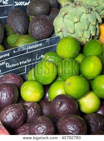 Exotic fruits on display at a greengrocer with european price tags and no brand names