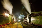 pic of former yugoslavia  - steam locomotives in depot at night - JPG