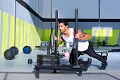 picture of sled  - sled push man pushing weights workout exercise - JPG
