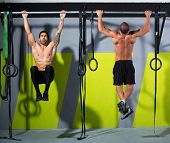 toes to bar men pull-ups 2 bars workout exercise at gym