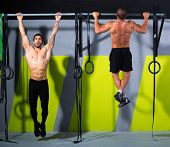 stock photo of rope pulling  - toes to bar men pull - JPG