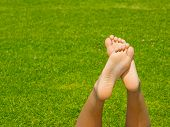 foto of filipina  - The soles of a young filipina in the park with the grass as the background - JPG