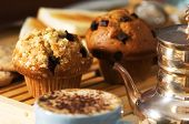 stock photo of chocolate-chip  - assortment of coffee cakes set on table with walnuts - JPG