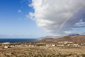 Impressing cloud formation and rainbow above the village of La Pared, Fuerteventura
