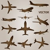 stock photo of biplane  - Vector set of brown planes or airplanes flying isolated on beige background - JPG
