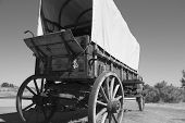 stock photo of covered wagon  - A historic covered wagon sits alongside the Snake River - JPG