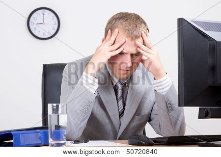 Young Tired Businessman Sitting In Office