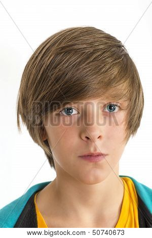 Teen Boy Smirking Into The Camera, Isolated On White