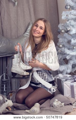 a Girl surrounded by festive Christmas paraphernalia