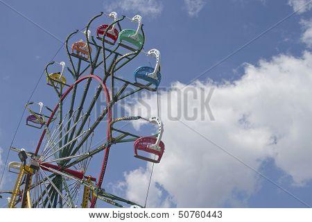 State Fair Ferris Wheel Against A Clear Blue Sky