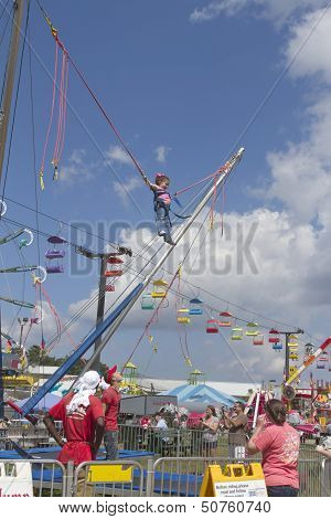 Child Having Fun Bungee Jumping At The North Carolina Mountain State Fair