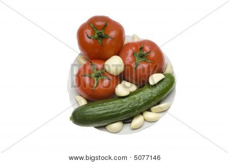 Tomatoes, Garlic, Cucumber On A Plate