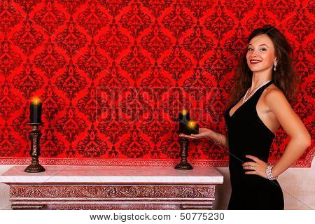 Girl With Candles Glamour Fashion Girl In Red Vintage Room With A Candle In Hand Luxury And Glossy
