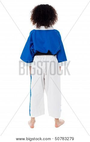 Back Pose Of A Small Girl In Karate Uniform
