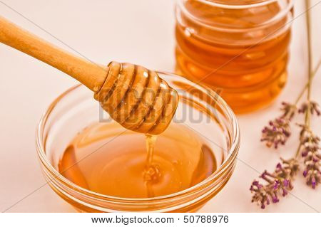 Bowl Of Honey With Wooden Dipper Drizzler