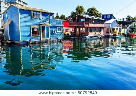 Floating Home Village Blue Red  Brown Houseboats Fisherman's Wharf Reflection Inner Harbor, Victoria