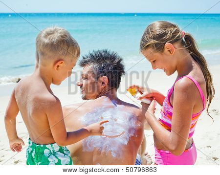 Applying sun cream