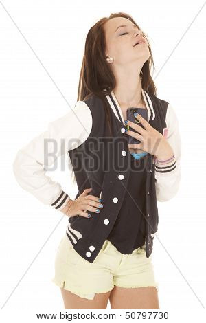 Girl Holding Onto Her Phone By Chest