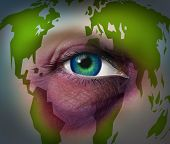 picture of mother law  - Global domestic violence and abusing mother earth concept with a violent bruised black eye on a human face with a world map as a symbol of injury to the environment and international law for the protection of women and human rights - JPG