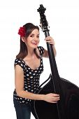 image of rockabilly  - A Beautiful Rockabilly Girl Smiling and Playing a Black Stand - JPG