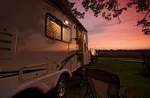stock photo of camper  - Travel Trailer in Sunset - JPG