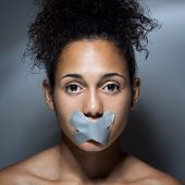 foto of freedom speech  - black woman with mouth covered with tape - JPG