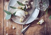 stock photo of ivory  - Vintage table setting with floral decorations napkins white roses leaves and berries on a wooden board background - JPG