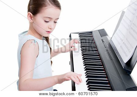 Little Girl Plays On The Electric Piano.