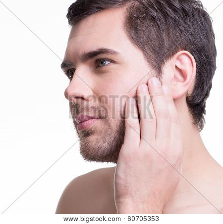 Handsome Man With Hand Near The Face.