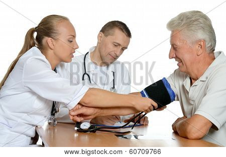 Young nurse measuring blood pressure