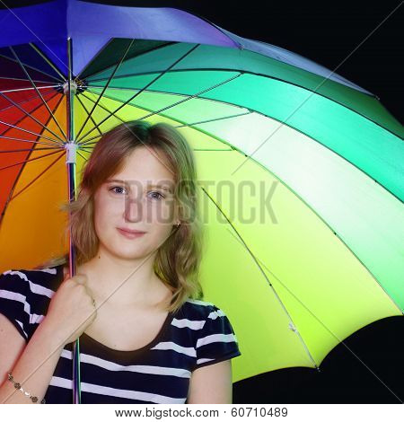 smiling girl with colorful umbrella