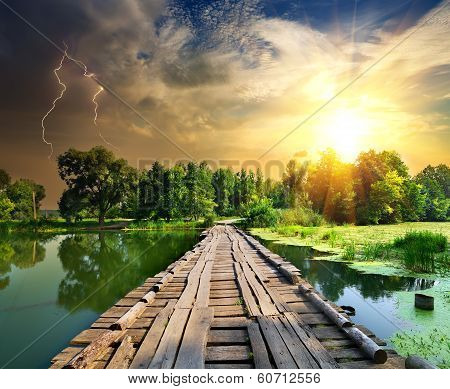 Lightning over the wooden bridge