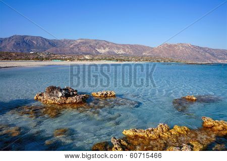 Small rocks outcropping on the edge of Elafonisos beach - one of the most fabulous in Europe - on the southwest coast of Crete, Greece