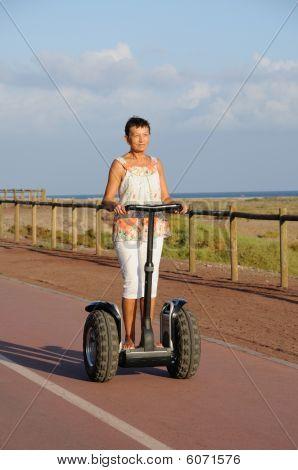 Pensioner Woman Driving Segway