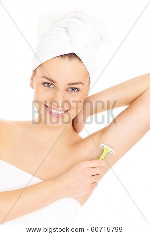 A picture of a young woman shaving her armpit over white background