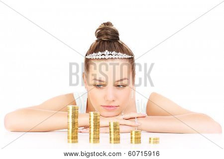 Young sad bride with gold coins over white background