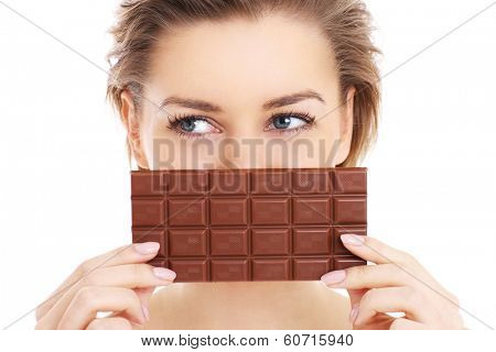 A picture of a pretty woman holding chocolate over white background