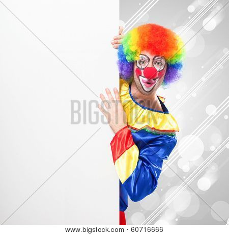 Smiling clown holding a blank sign