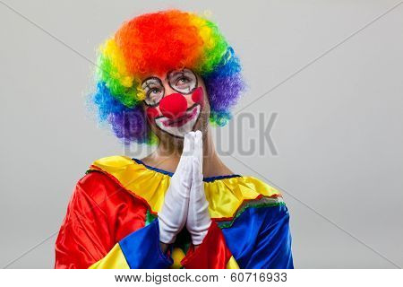 Funny clown praying