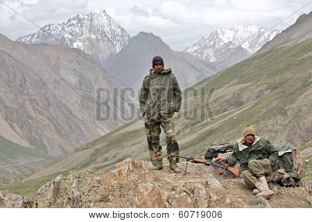 JAMMU AND KASHMIR, INDIA - JULY 17, 2006: Indian Army uniformed personnel in Kashmir Himalayas mountains.