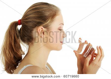 Young woman drinking fresh cold water from glass - isolated on white