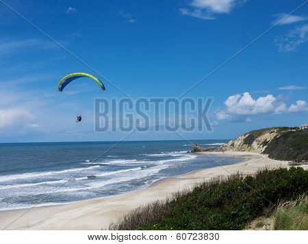 Paraglider in flight with  blue sky strong